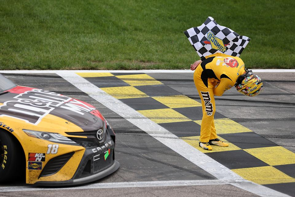 KANSAS CITY, KANSAS - MAY 02: Kyle Busch, driver of the #18 M&M's Mix Toyota, takes a bow after winning the NASCAR Cup Series Buschy McBusch Race 400 at Kansas Speedway on May 02, 2021 in Kansas City, Kansas. (Photo by James Gilbert/Getty Images)