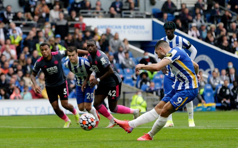 Neal Maupay of Brighton & Hove Albion scores their side's first goal from the penalty spot during the Premier League match between Brighton & Hove Albion and Leicester City at American Express Community Stadium on September 19, 2021 in Brighton, England. - GETTY IMAGES