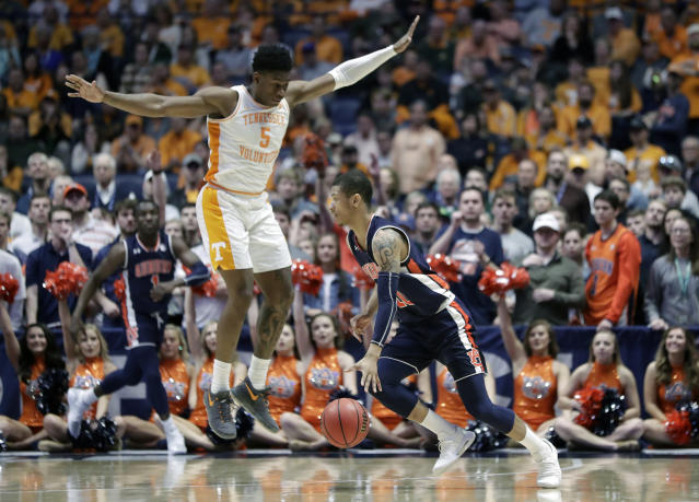 Auburn's Samir Doughty drives around Tennessee's Admiral Schofield (5) in the second half of the NCAA college basketball Southeastern Conference championship game Sunday, March 17, 2019, in Nashville, Tenn. (AP Photo/Mark Humphrey)