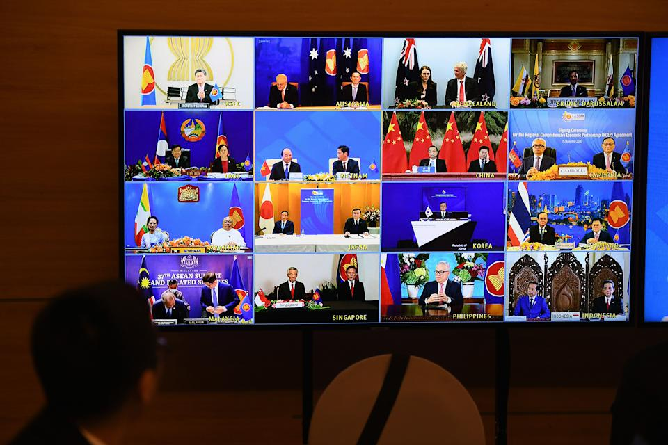 Representatives of signatory countries are pictured on screen during the signing ceremony for the Regional Comprehensive Economic Partnership (RCEP) trade pact at the ASEAN summit that is being held online in Hanoi on November 15, 2020. (Photo by Nhac NGUYEN / AFP) (Photo by NHAC NGUYEN/AFP via Getty Images)