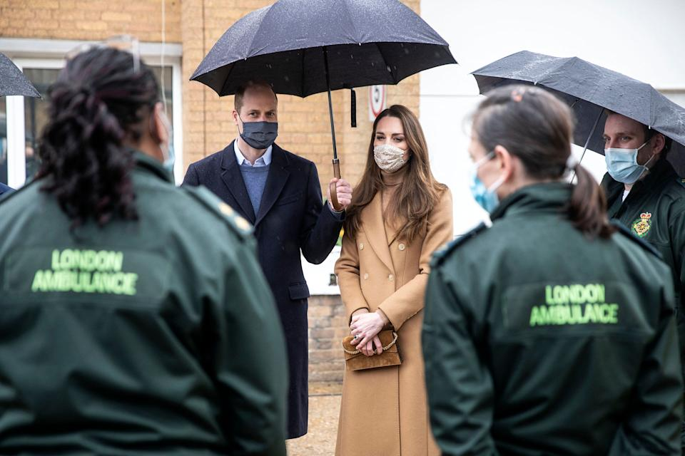 Britain's Prince William, Duke of Cambridge (L) and Britain's Catherine, Duchess of Cambridge (2R), both wearing face coverings due to Covid-19, talk with members of the ambulance service in the wellbeing garden during a visit to Newham Ambulance Station in east London on March 18, 2021, where they learned about their experiences during the coronavirus pandemic. (Photo by RICHARD POHLE / POOL / AFP) (Photo by RICHARD POHLE/POOL/AFP via Getty Images)