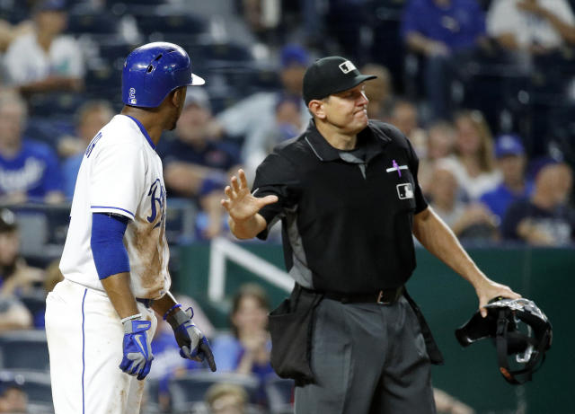 Kansas City Royals' Alcides Escobar is ejected from the game by home plate umpire Chad Fairchild during the eighth inning of a baseball game against the Texas Rangers Wednesday, June 20, 2018, in Kansas City, Mo. (AP Photo/Charlie Riedel)