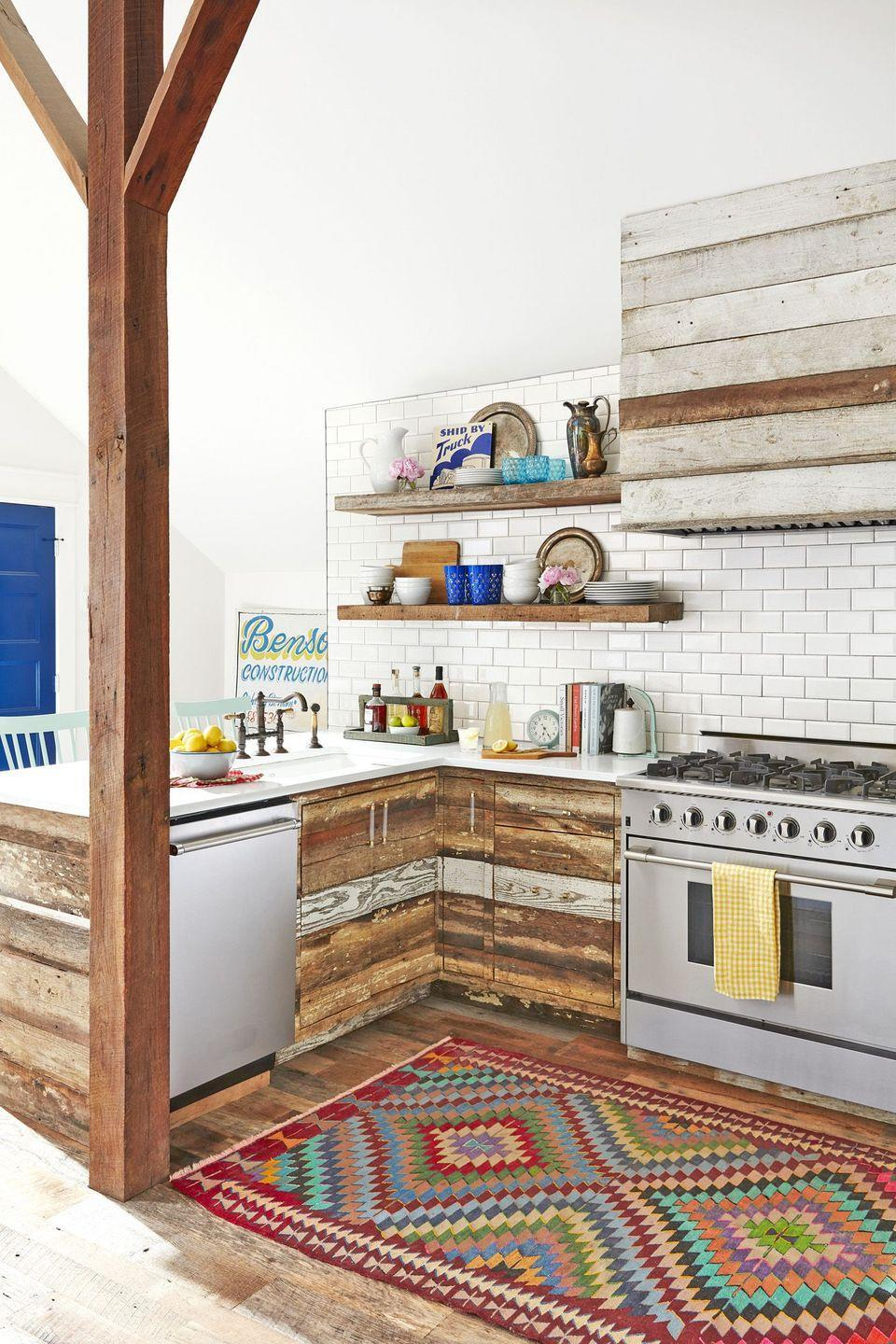 "<p>If you feel inclined to give more attention to your appliances, backsplash, or accessories, then you're going to be the first to embrace this new trend. Let your other kitchen elements steal the show with a sleek and minimalistic range hood like <a href=""https://www.countryliving.com/home-design/house-tours/g20955378/converted-barn-home-nashville-tennessee/"" rel=""nofollow noopener"" target=""_blank"" data-ylk=""slk:this one"" class=""link rapid-noclick-resp"">this one</a> fashioned to blend in with the former chicken coop cabinets.</p><p><a class=""link rapid-noclick-resp"" href=""https://www.amazon.com/Kitchen-Rugs/b?ie=UTF8&node=644050011&tag=syn-yahoo-20&ascsubtag=%5Bartid%7C10050.g.3988%5Bsrc%7Cyahoo-us"" rel=""nofollow noopener"" target=""_blank"" data-ylk=""slk:SHOP KITCHEN RUGS"">SHOP KITCHEN RUGS</a></p>"