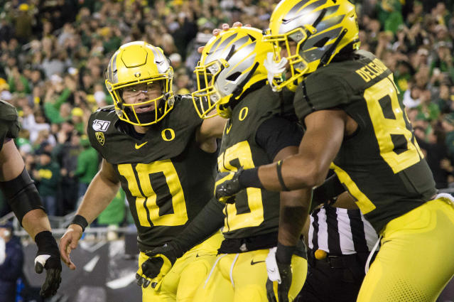 Oregon Ducks quarterback Justin Herbert (10) celebrates a touchdown by wide receiver Jaylon Redd (30) during the second half at Autzen Stadium. Oregon won the game 17-7. (USAT)