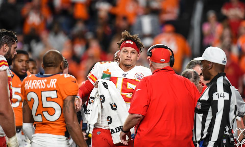 Patrick Mahomes leaves Thursday night's game against Denver with a knee injury. (Getty Images)