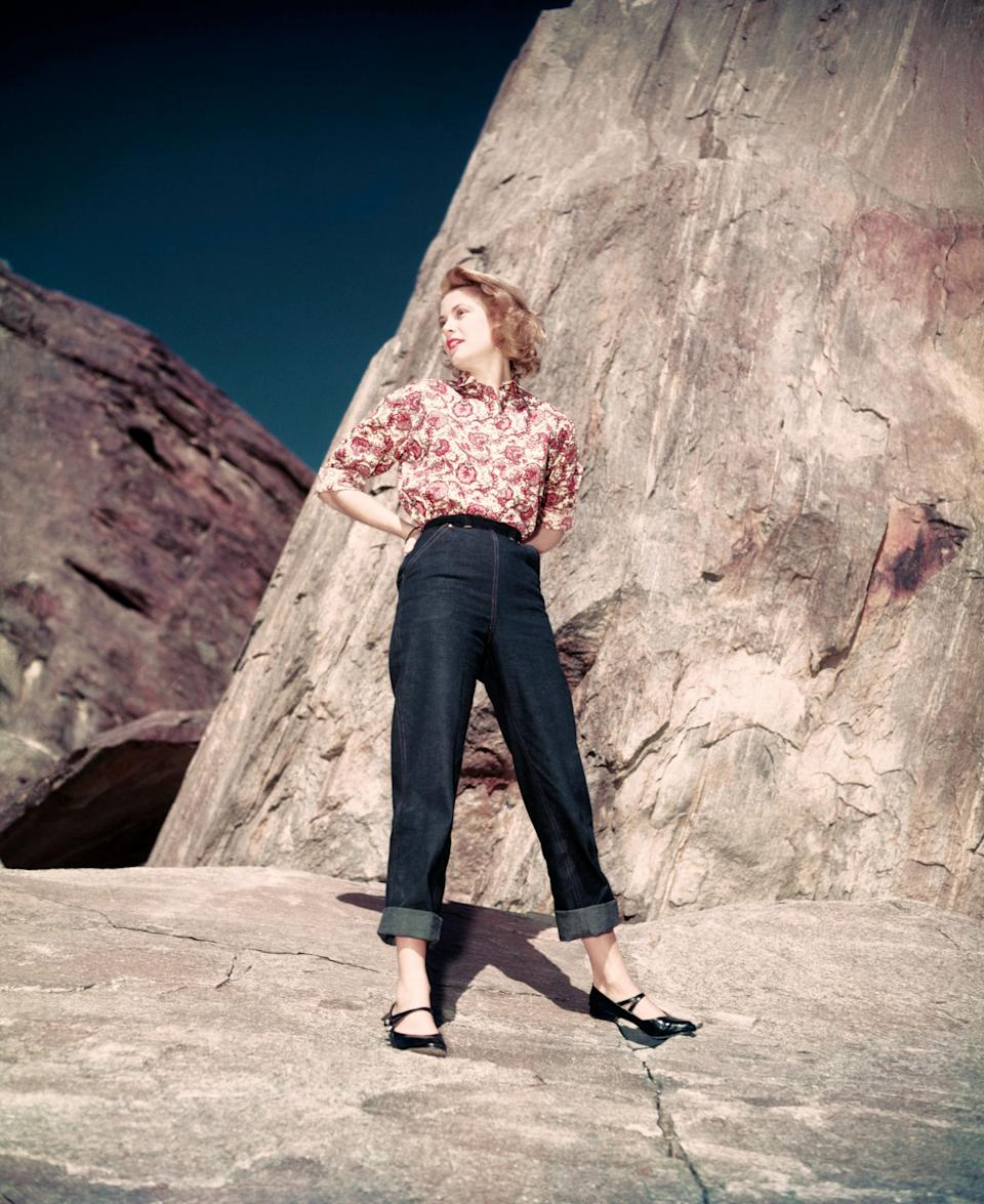 Grace Kelly, known as Princess Grace of Monaco, stands among the rocks in a photo from around 1955.