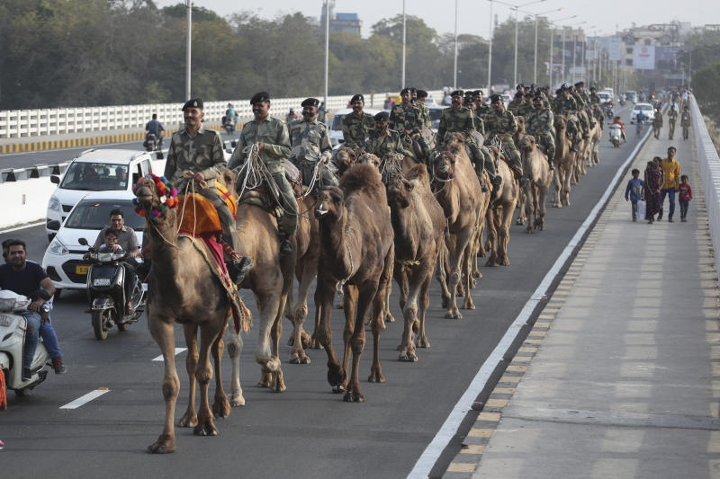 "Border Security Force (BSF) soldiers march on the route that U.S. President Donald Trump will travel in Ahmadabad, India, Friday, Feb. 21, 2020. Trump is visiting the city of Ahmedabad in Gujarat during a two-day trip to India to attend an event called ""Namaste Trump,"" which translates to ""Greetings, Trump,"" at a cricket stadium along the lines of a ""Howdy Modi"" rally attended by Indian Prime Minister Narendra Modi in Houston last September. (AP Photo/Ajit Solanki)"