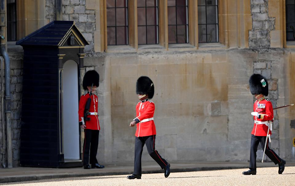 Members of the Household Division arrive in preparation for a ceremony to mark Britain's Queen Elizabeth II official birthday, at Windsor Castle in Windsor, southeast England on June 13, 2020, as Britain's Queen Elizabeth II celebrates her 94th birthday this year. (Photo by TOBY MELVILLE / POOL / AFP) (Photo by TOBY MELVILLE/POOL/AFP via Getty Images)