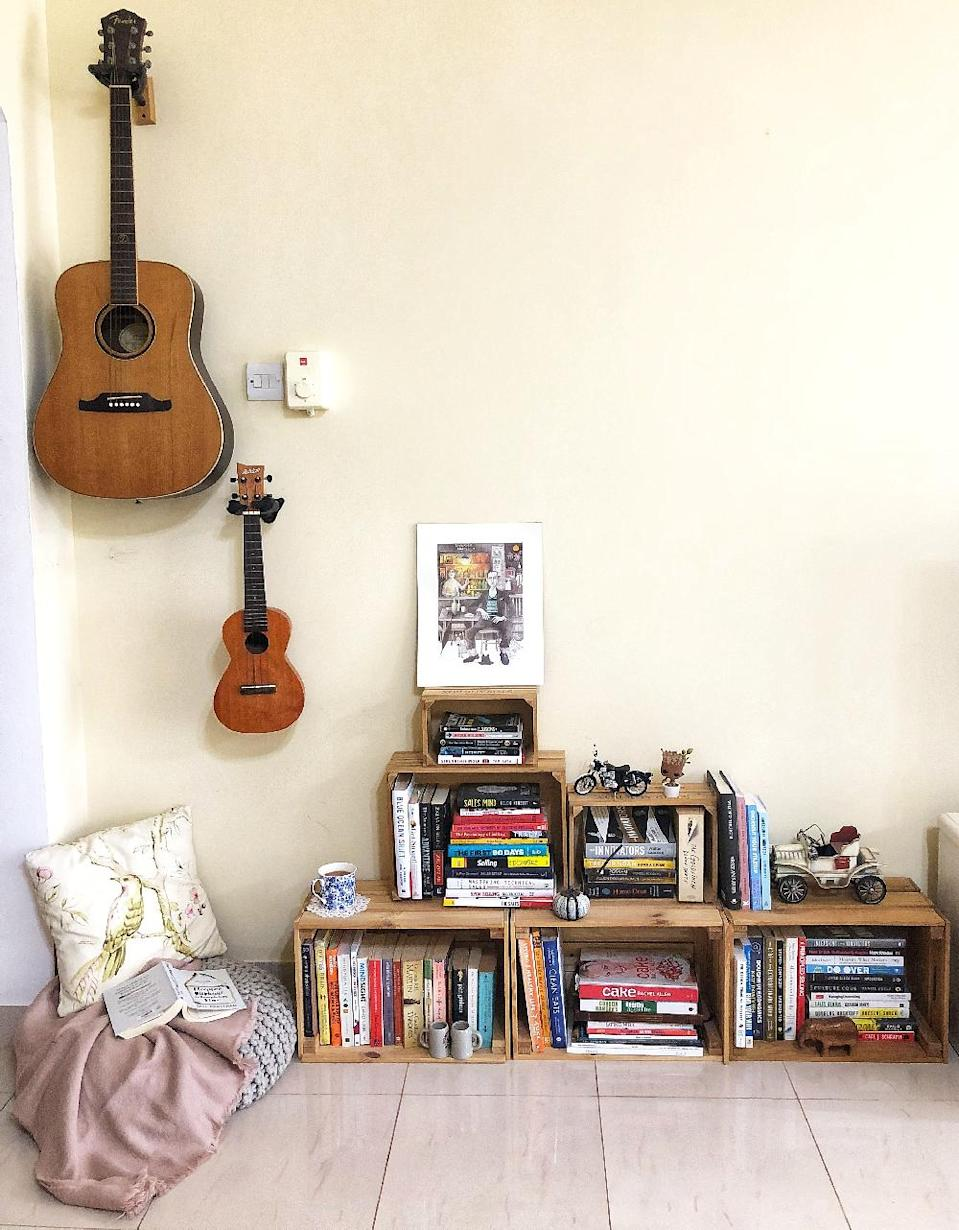 Our little reading nook. We didn't want a very big bookcase. The stacked up wooden crates work as a great alternative.