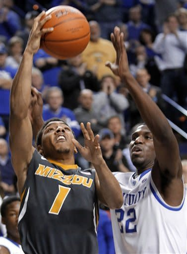 Kentucky's Alex Poythress, right, pressures Missouri's Phil Pressey's during the second half of an NCAA college basketball game at Rupp Arena in Lexington, Ky., Saturday, Feb. 23, 2013. Kentucky won 90-83 in overtime. (AP Photo/James Crisp)