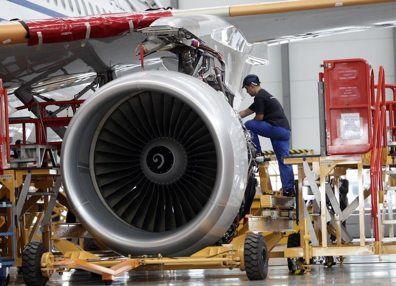 An employee installs an engine for an A320 plane under construction in Tianjin municipality