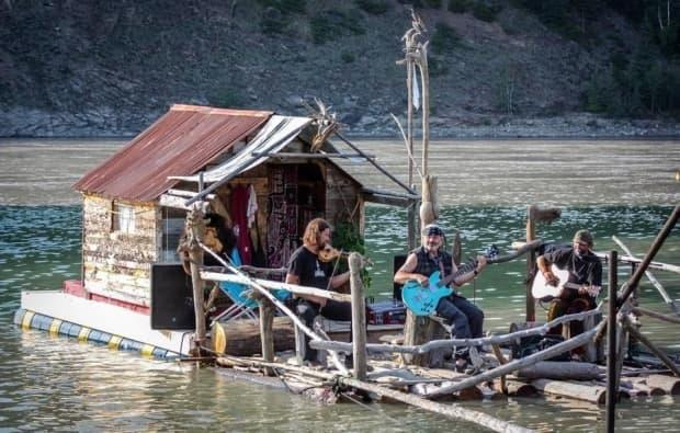 Dawson City musician Holly Haustein, who goes by the name Driftwood Holly as a musician, performs with his friends on his houseboat, The Wooden Pearl, on the Yukon River in Dawson City. (Photo submitted by Driftwood Holly. - image credit)