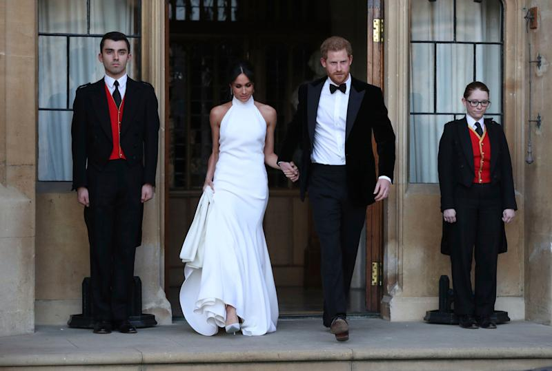Meghan and Harry step out at their wedding reception. (Photo: ASSOCIATED PRESS)
