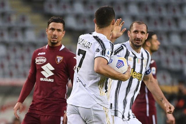Juventus' Cristiano Ronaldo congratulates team-mate Giorgio Chiellini after scoring against Torino
