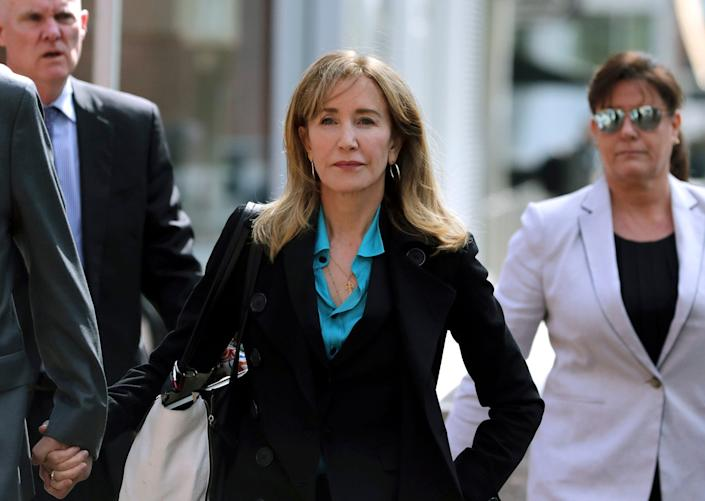 Felicity Huffman arrives at federal court in Boston to face charges in a nationwide college admissions bribery scandal.