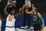 Boston Celtics guard Romeo Langford (45) deflects the ball away from New York Knicks forward Julius Randle (30) during the second half of an NBA basketball game in New York, Sunday, May 16, 2021. (Vincent Carchietta/Pool Photo via AP)