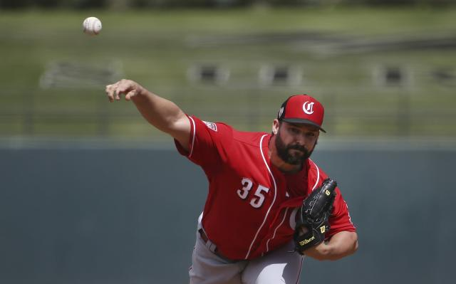 Cincinnati Reds starter Tanner Roark throws a pitch to a Texas Rangers batter during the first inning of a spring training baseball game Wednesday, March 20, 2019, in Surprise, Ariz. (AP Photo/Ross D. Franklin)