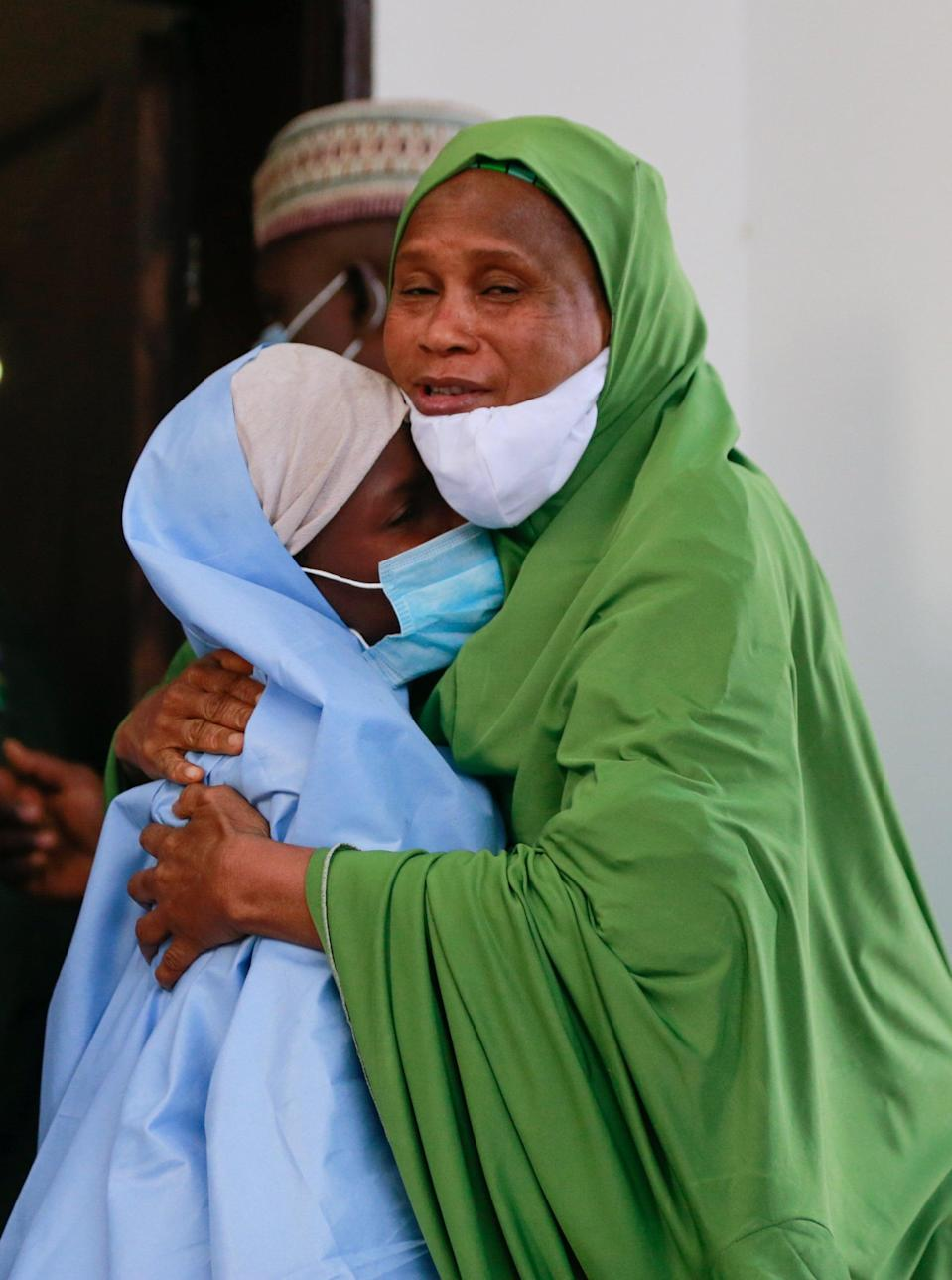 An official embraces one of the victims.REUTERS