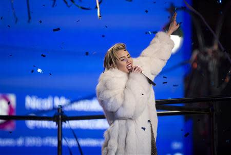 Singer Miley Cyrus performs during New Year's Eve celebrations at Times Square in New York, December 31, 2013. REUTERS/Carlo Allegri