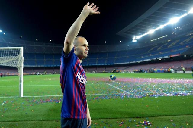 Barcelona's Spanish midfielder Andres Iniesta waves at the end of a tribute after the Spanish league football match between FC Barcelona and Real Sociedad at the Camp Nou stadium