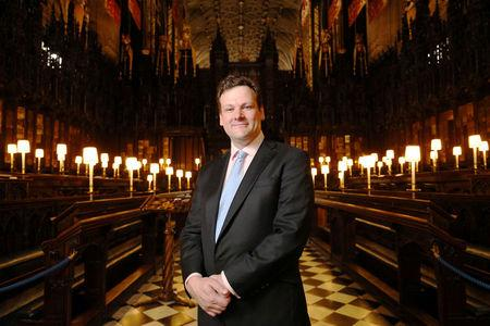 James Vivian, Organist and Director of Music at St George's Chapel in Windsor Castle where Britain's Prince Harry and Meghan Markle will marry next month poses for a picture in the Chapel in Windsor, April 23, 2018. Jonathan Brady/Pool via Reuters