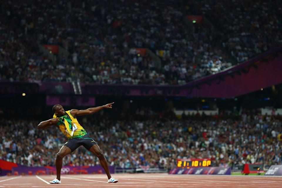 LONDON, ENGLAND - AUGUST 09: Usain Bolt of Jamaica celebrates after winning gold in the Men's 200m Final on Day 13 of the London 2012 Olympic Games at Olympic Stadium on August 9, 2012 in London, England. (Photo by Michael Steele/Getty Images)