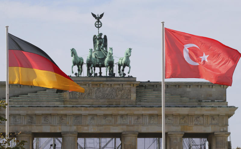 In this Sept. 26, 2018 photo the German and the Turkish flag flutter in front of the Brandenburg Gate in Berlin where Turkish President Recep Tayyip Erdogan is expected to arrive on Thursday, Sept. 27, 2018 for a three-day official state visit. (Wolfgang Kumm/dpa via AP)