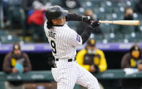 Colorado Rockies' Connor Joe checks his swing while facing San Diego Padres starting pitcher Dinelson Lamet during the second inning of a baseball game Tuesday, May 11, 2021, in Denver. (AP Photo/David Zalubowski)
