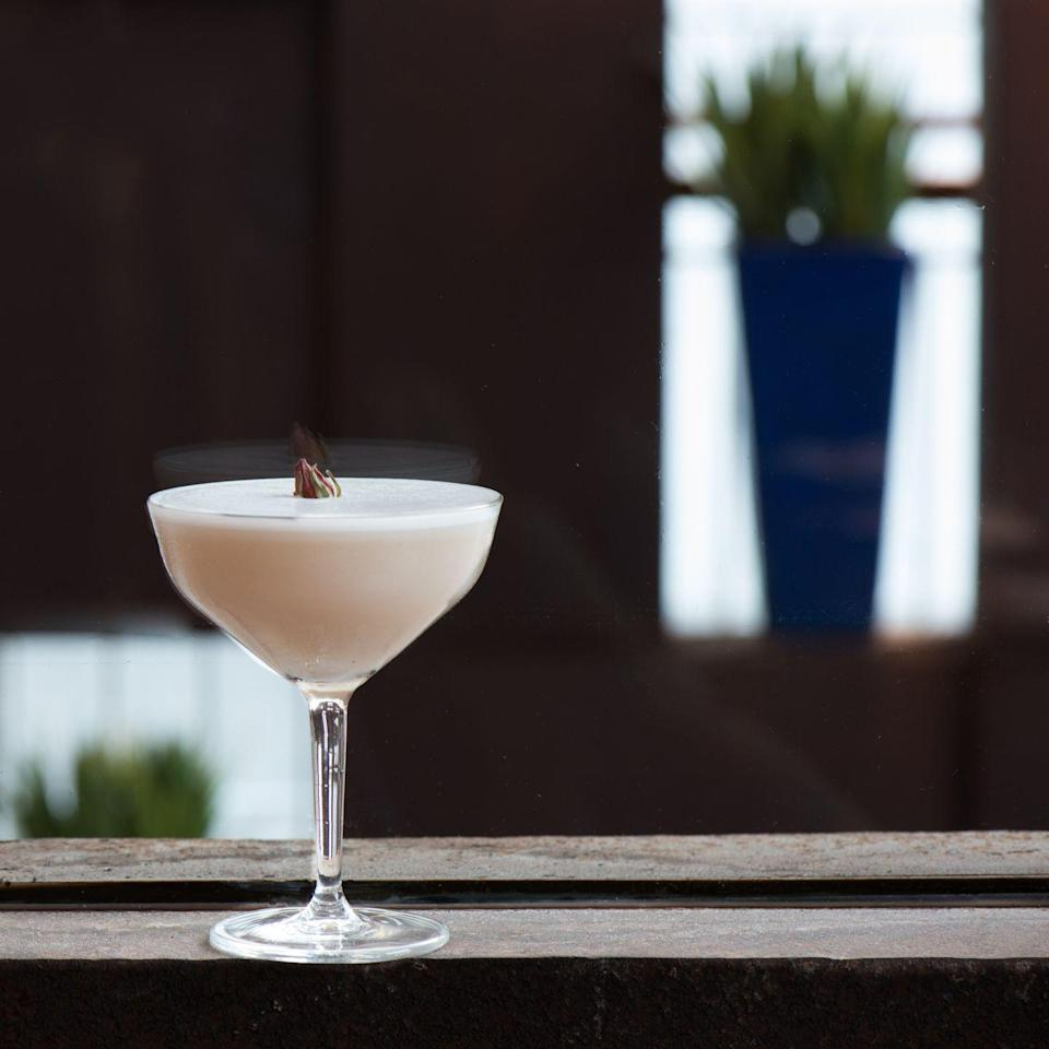 """<p>This chic cocktail can be found at The Cosmopolitan of Las Vegas' popular bar, <a href=""""https://zumarestaurant.com/locations/las-vegas/"""" rel=""""nofollow noopener"""" target=""""_blank"""" data-ylk=""""slk:Zuma"""" class=""""link rapid-noclick-resp"""">Zuma</a>, and will wow any crowd.</p><p><strong>Ingredients:</strong></p><p>1 3/4 ounces vodka or gin</p><p>2 ounces lychee purée</p><p>3/4 ounces freshly squeezed lemon juice </p><p>1/5 ounce rose syrup</p><p>pinch salt,</p><p>rosebud or rose petal, for garnish</p><p><strong>Directions:</strong></p><ol><li>Combine liquor of choice with lychee purée, lemon juice, rose syrup, and salt in a cocktail shaker.</li><li>Shake and double-strain into a chilled martini glass.</li><li>Garnish with a rosebud or rose petal. </li></ol>"""