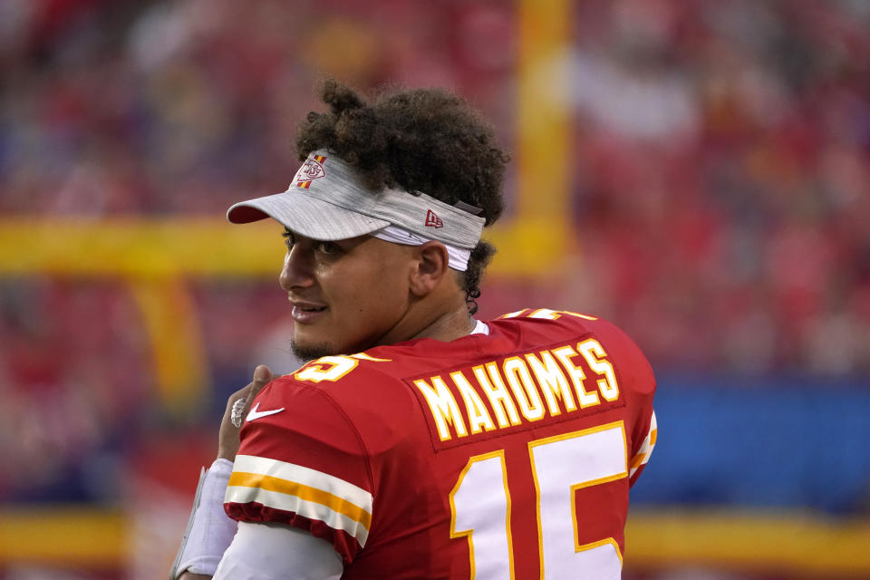 Kansas City Chiefs quarterback Patrick Mahomes watches from the sidelines during the first half of an NFL football game against the Minnesota Vikings Friday, Aug. 27, 2021, in Kansas City, Mo. (AP Photo/Ed Zurga)