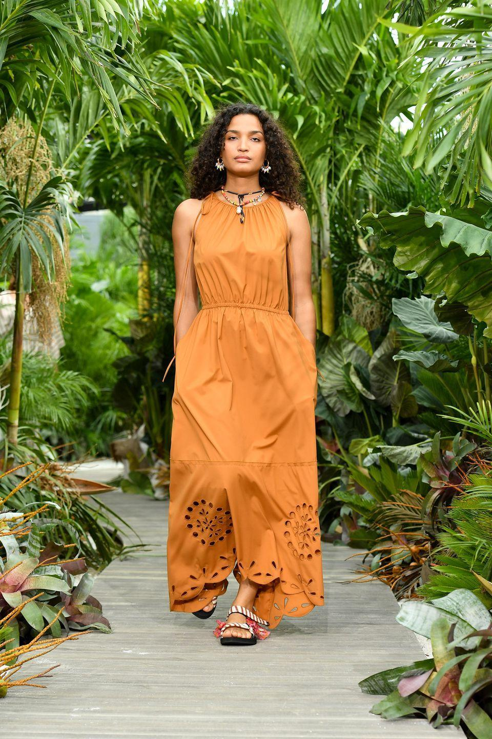 """<p>Jason Wu is one of the few designers who presented in-person for New York Fashion Week, keeping his show small and adhering to COVID-19 restrictions. Set against tropical foliage on a boardwalk-inspired runway that calls to mind one of Wu's favorite destinations, Tulum, Mexico, the designer showed a range of easy warm-weather ready maxi dresses and suiting in bold, bright shades of orange and yellow, offset with blues and greens. The cotton poplins and lightweight knits are part of his new contemporary-priced line, and serve as inviting propositions to wear on an escape from the city—or for a new life in closer proximity to nature. Wu took his bow wearing one of the<a href=""""https://www.distanceyourselffromhate.org/purchase"""" rel=""""nofollow noopener"""" target=""""_blank"""" data-ylk=""""slk:""""Distance Yourself From Hate"""" masks"""" class=""""link rapid-noclick-resp""""> """"Distance Yourself From Hate"""" masks</a> he designed in collaboration with Fabien Baron to benefit Gay Men's Health Crisis, an organization food and PPE to communities of color who have been disproportionately affected by the coronavirus pandemic and social injustice. —<em>Kerry Pieri</em></p>"""