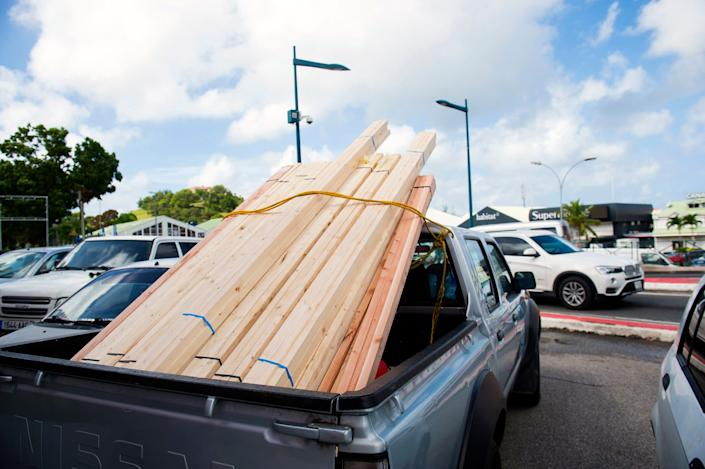 A picutre taken on September 5, 2017 shows timber in a truck as people buy goods as part of preparations for arrival of Hurricane Irma in Marigot, on the French overseas island of Saint-Martin.