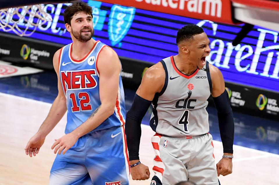 Russell Westbrook of the Washington Wizards celebrates in front of Joe Harris of the Brooklyn Nets