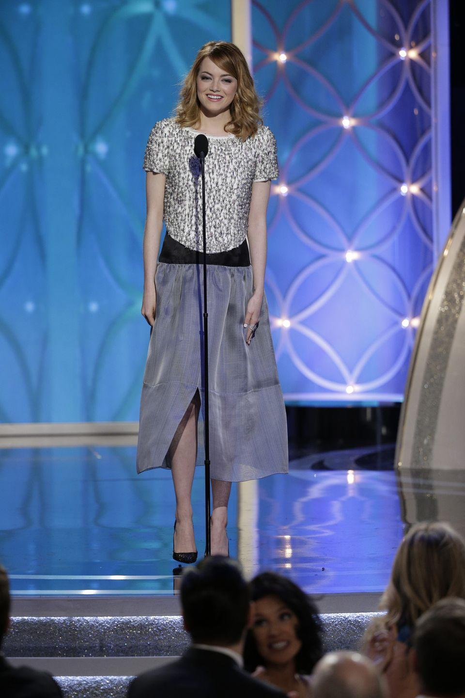 <p>We have so many questions about this look Stone wore to present at the ceremony in 2014.</p>