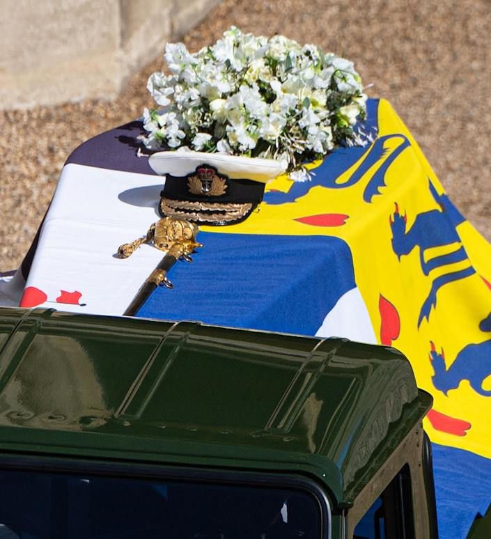 The Duke of Edinburgh's coffin, covered with His Royal Highness's Personal Standard, is seen on the Land Rover that he had helped modify for his funeral.