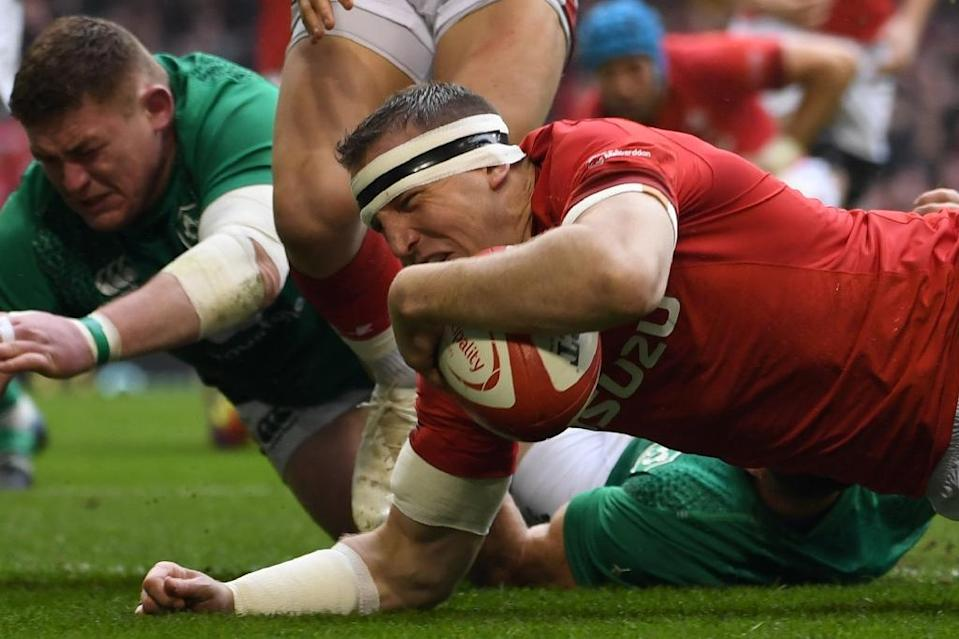 Hadleigh Parkes set the tone of the 25-7 thumping of Ireland by Wales with an early try and then a superb try-saving tackle on Jacob Stockdale (AFP Photo/Paul ELLIS)