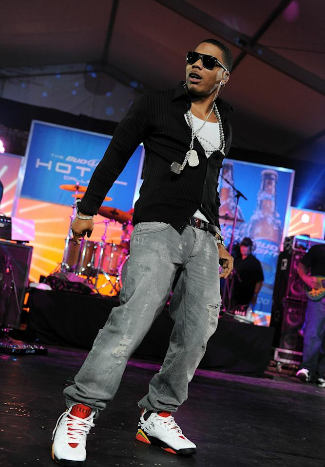 DALLAS, TX - FEBRUARY 05:  Nelly performs onstage during the Bud Light Hotel event with performances by Nelly, Ke$ha and Pitbull on February 5, 2011 in Dallas, Texas.  (Photo by Jordan Strauss/Getty Images for Bud Light)