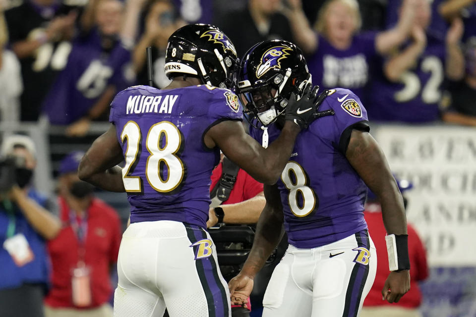 Baltimore Ravens running back Latavius Murray (28) celebrates his touchdown with quarterback Lamar Jackson in the first half of an NFL football game against the Kansas City Chiefs, Sunday, Sept. 19, 2021, in Baltimore. (AP Photo/Julio Cortez)
