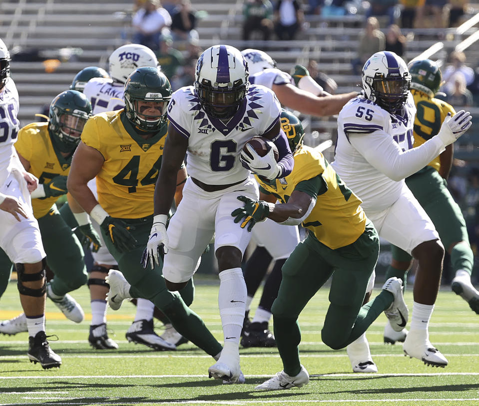 TCU running back Zach Evans (6) runs through the Baylor defense in the first half of an NCAA college football game in Waco, Texas, Saturday, Oct. 31, 2020. (Jerry Larson/Waco Tribune-Herald via AP)