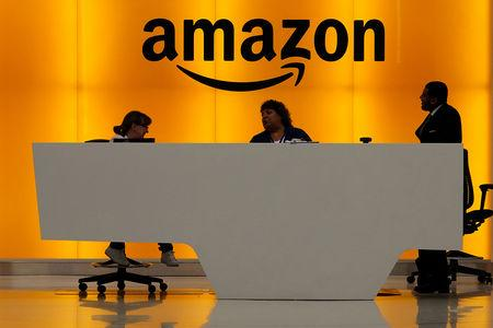 FILE PHOTO: Staff chat at the front desk of the Amazon office in the Manhattan borough of New York, New York, U.S., May 1, 2019.   REUTERS/Carlo Allegri/File Photo