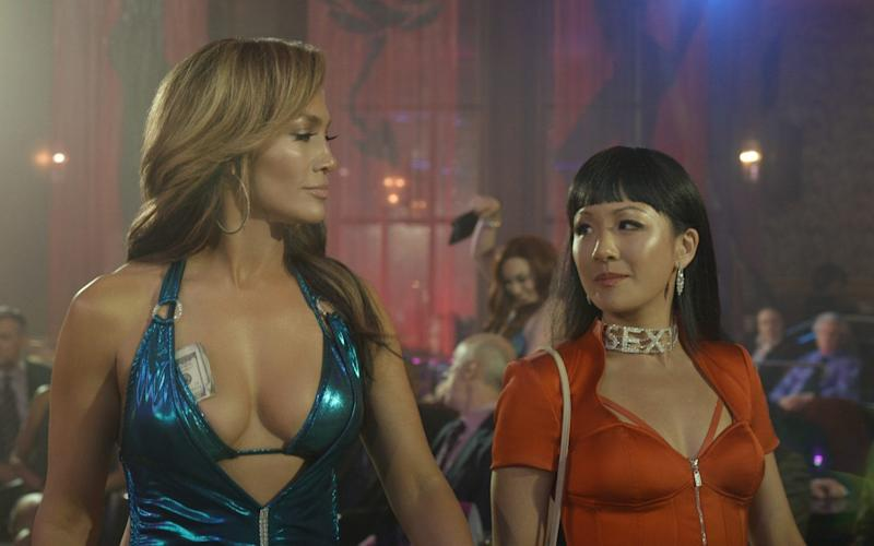 Jennifer Lopez and Constance Wu in a scene from Hustlers - A136_C010_050190
