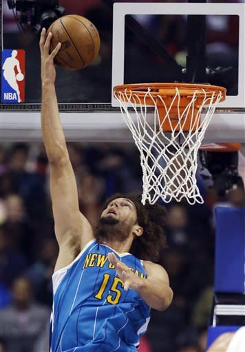 New Orleans Hornets center Robin Lopez scores against the Los Angeles Clippers during the first half of an NBA basketball game in Los Angeles, Monday, Nov. 26, 2012. (AP Photo/Chris Carlson)