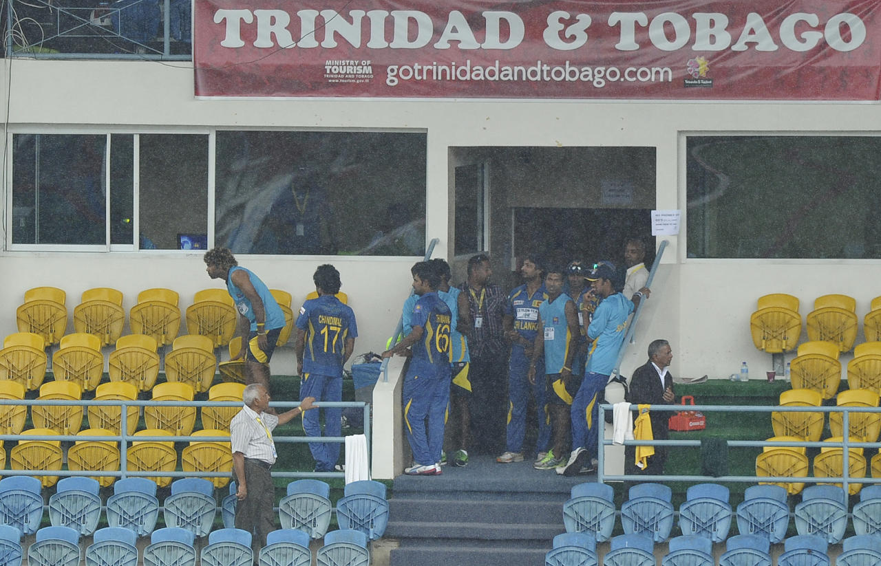 Sri Lankan cricketers are seen outside their dressing room as rain interrupted the fifth match of the Tri-Nation series between Sri Lanka and West Indies at the Queen's Park Oval stadium in Port of Spain on July 7, 2013. Persistent rain caused the match to be called off for the day after only 19 overs were bowled during Sri Lanka's innings with a score of 60/3. The match will continue from the current state on July 8. AFP PHOTO/Jewel Samad        (Photo credit should read JEWEL SAMAD/AFP/Getty Images)