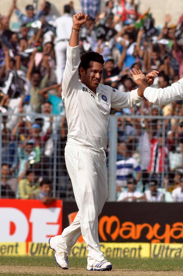 Indian cricketer Sachin Tendulkar celebrates after taking wicket of West Indian batsman Shane Shillingford during the 1st day of the 1st test match between India and West Indies at Eden Gardens, Kolkata on Nov. 6, 2013. (Photo: IANS)