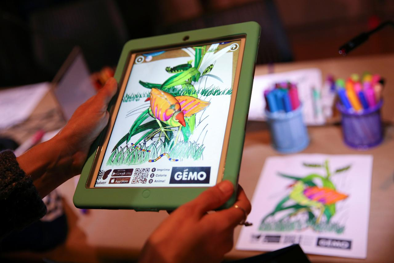 A visitor plays with Quiver on an iPad, an application by QuiverVision which brings drawings to life, at Teknopolis, a participatory arts-tech exhibit at the Brooklyn Academy of Music (BAM) in Brooklyn, New York, U.S., February 25, 2017.  REUTERS/Ashlee Espinal