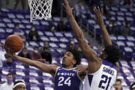 Kansas State guard Nijel Pack (24) shoots next to TCU center Kevin Samuel (21) during the second half of an NCAA college basketball game Saturday, Feb. 20, 2021, in Fort Worth, Texas. (AP Photo/Richard W. Rodriguez)