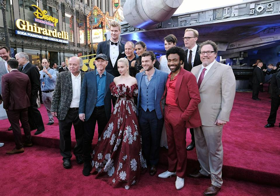 "<p>(Back Row) Joonas Suotamo, Woody Harrelson, Thandie Newton, Phoebe Waller-Bridge, Paul Bettany, (Front Row) Clint Howard, Ron Howard, Emilia Clarke, Alden Enrenreich, Donald Glover, Jon Favreau attend the world premiere of ""Solo: A Star Wars Story"" in Hollywood on May 10, 2018..(Photo: Alex J. Berliner/ABImages). </p>"