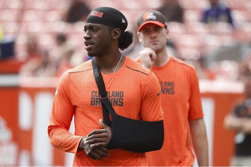 FILE - In this Sept. 18, 2016, file photo, Cleveland Browns quarterback Robert Griffin III walks the field with his arm in a sling during practice before an NFL football game against the Baltimore Ravens, in Cleveland. A person familiar with the decision says the Cleveland Browns are releasing quarterback Robert Griffin III after one injury-marred season. Griffin is being let go one day before he would have been due a $750,000 roster bonus, said the person who spoke Friday, March 10, 2017, to the Associated Press on condition of anonymity because the team has not announced the move. (AP Photo/Ron Schwane, File)