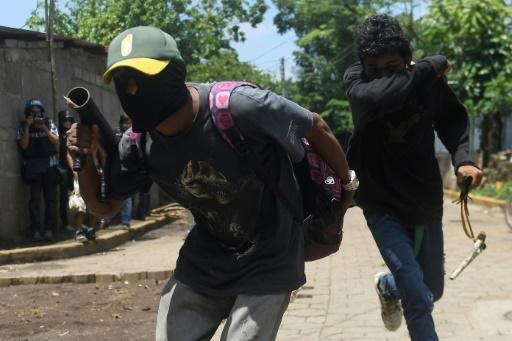Protesters confront anti-riot police in Masaya on Thursday