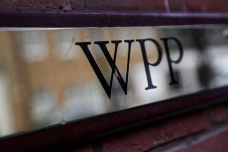 FILE PHOTO: A logo hangs on the wall outside the WPP offices in London, Britain April 30, 2018. REUTERS/Simon Dawson/File Photo